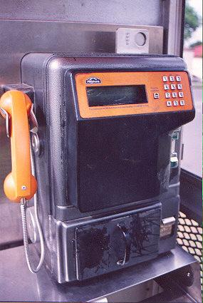 "Formerly the most up-to-date phones, still the most prevalent.  Moving LCD.  Phonecard slot with the green arrows on the far side.  Two locks on the near side: both are double-sided key-pin locks.  Top opens the phone, bottom unlocks the coin drawer.</BR></BR><span class=""date-display-single"" property=""dc:date"" datatype=""xsd:dateTime"" content=""1997-11-12T00:00:00+00:00"">Nov 12, 1997</span>"